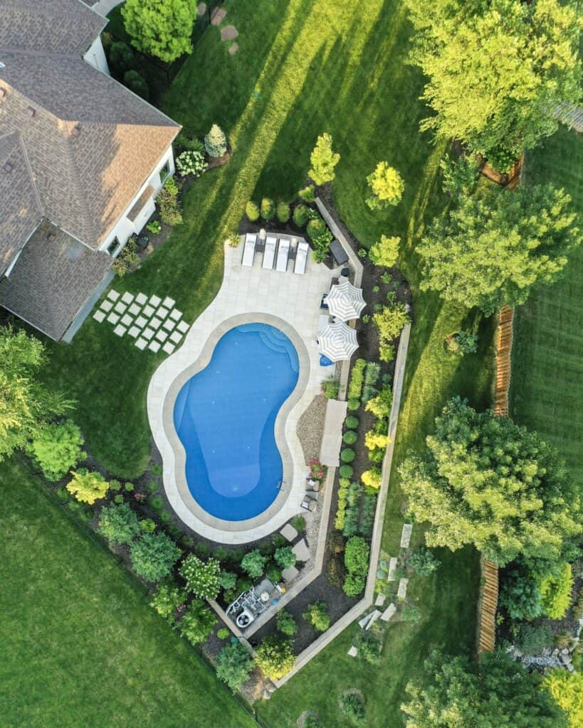 An aerial view of our oasis shaped swimming pool.