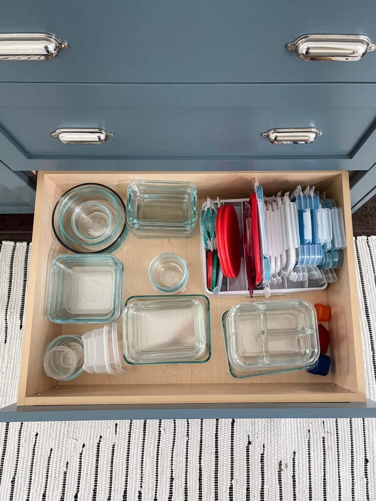 Tips on how to organize kitchen drawers, including food storage containers and lids.