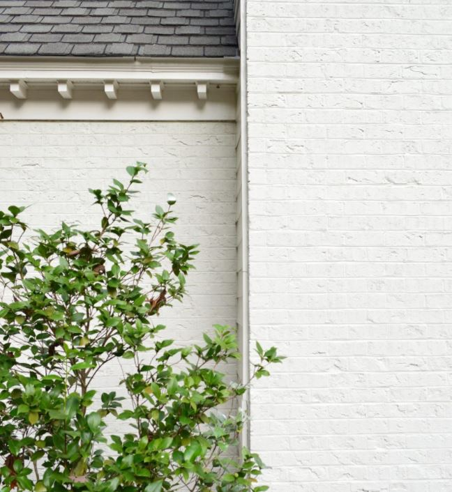 Limewash white brick using Romabio paints via Young House Love.