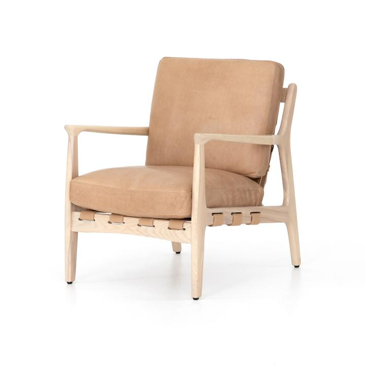 A light leather armchair with light ash wood frame. Perfect for a modern coastal living room chair!