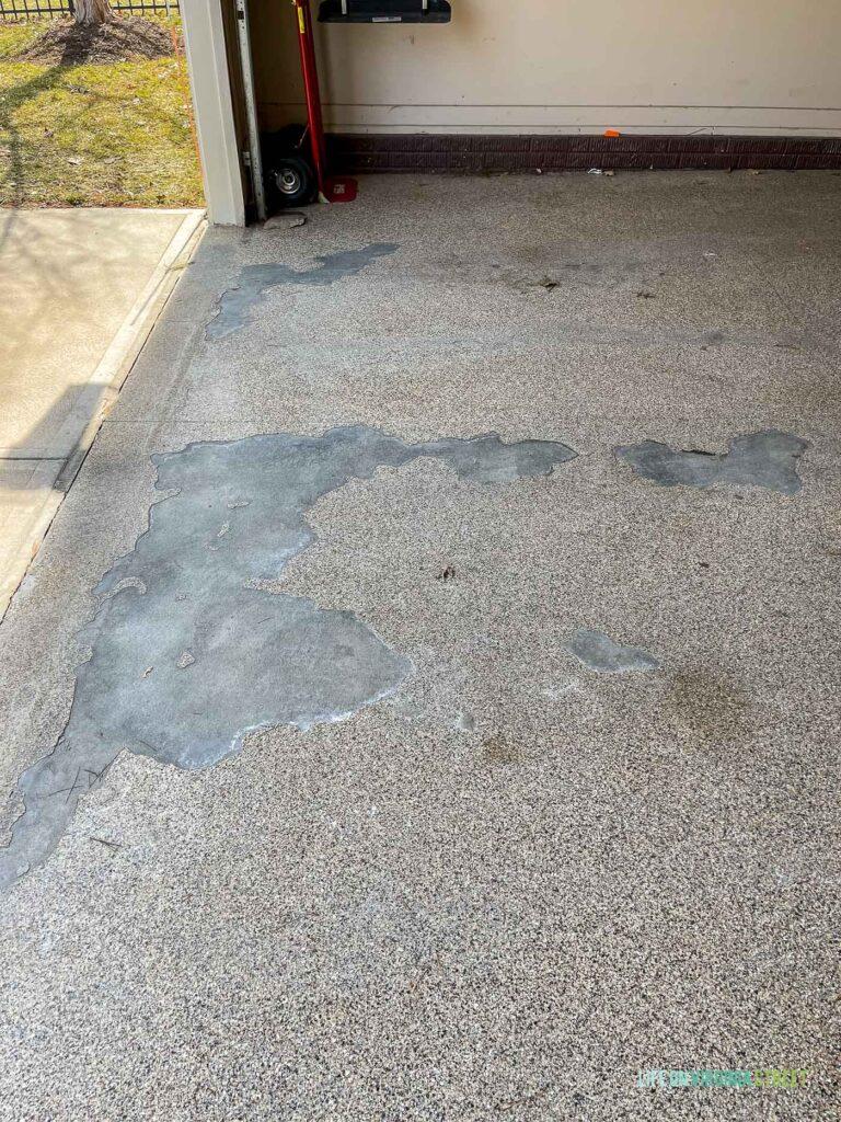 Peeling and flaking epoxy garage floor coating.