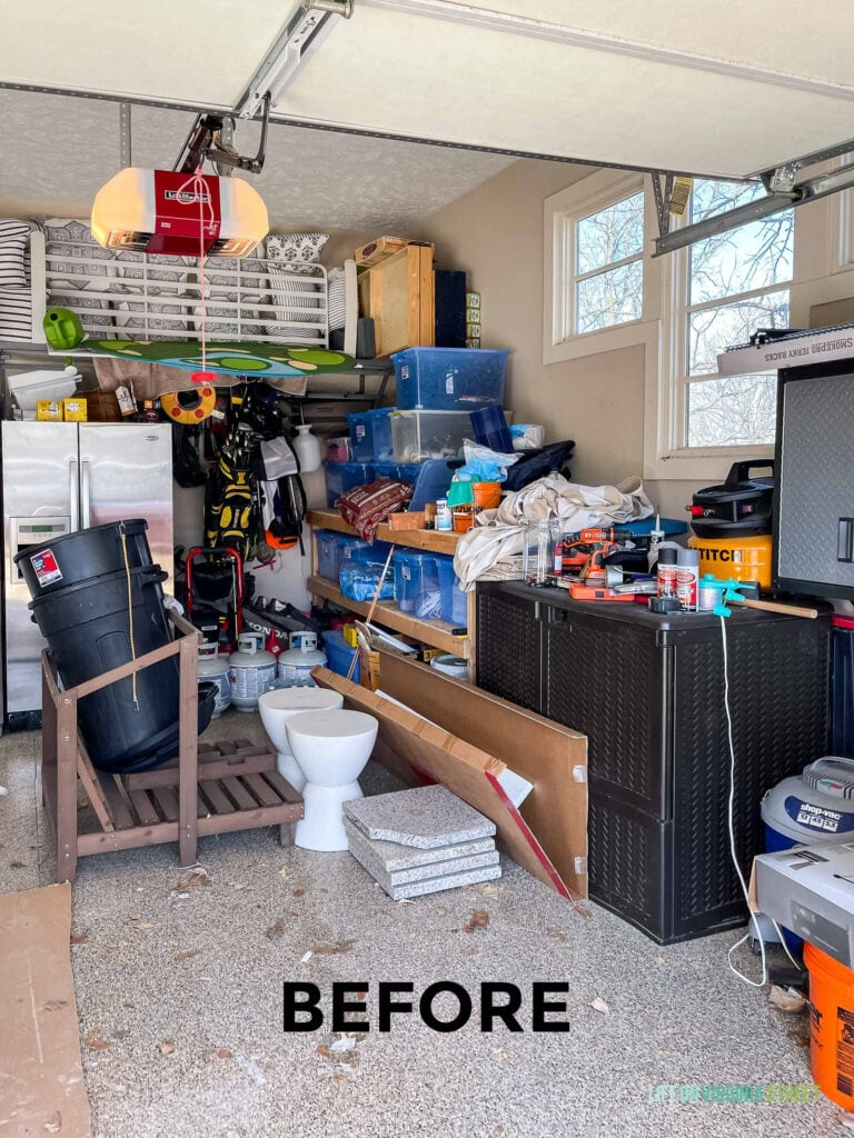 Our messy garage before we had a new garage floor coating installed and organizational pieces added.