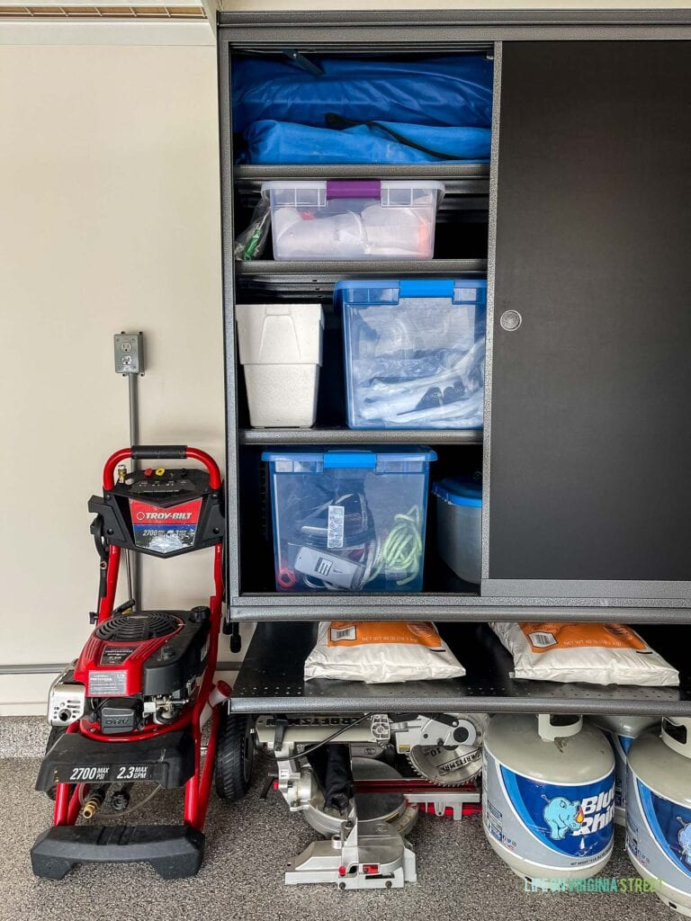 Garage storage cabinet with sliding doors to save on space and help keep the garage organized!