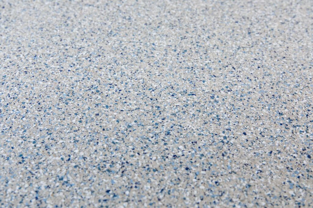 A close-up picture of polyaspartic garage floor coating.