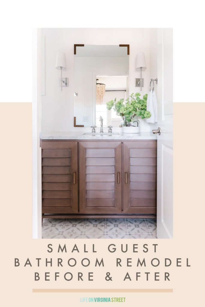 A before & after small guest bathroom remodel reveal featuring a louvered wood bathroom vanity, patterned tile floors, chrome sconce lights flanking a vertical mirror, and faux viburnum stems in a paint dipped vase.