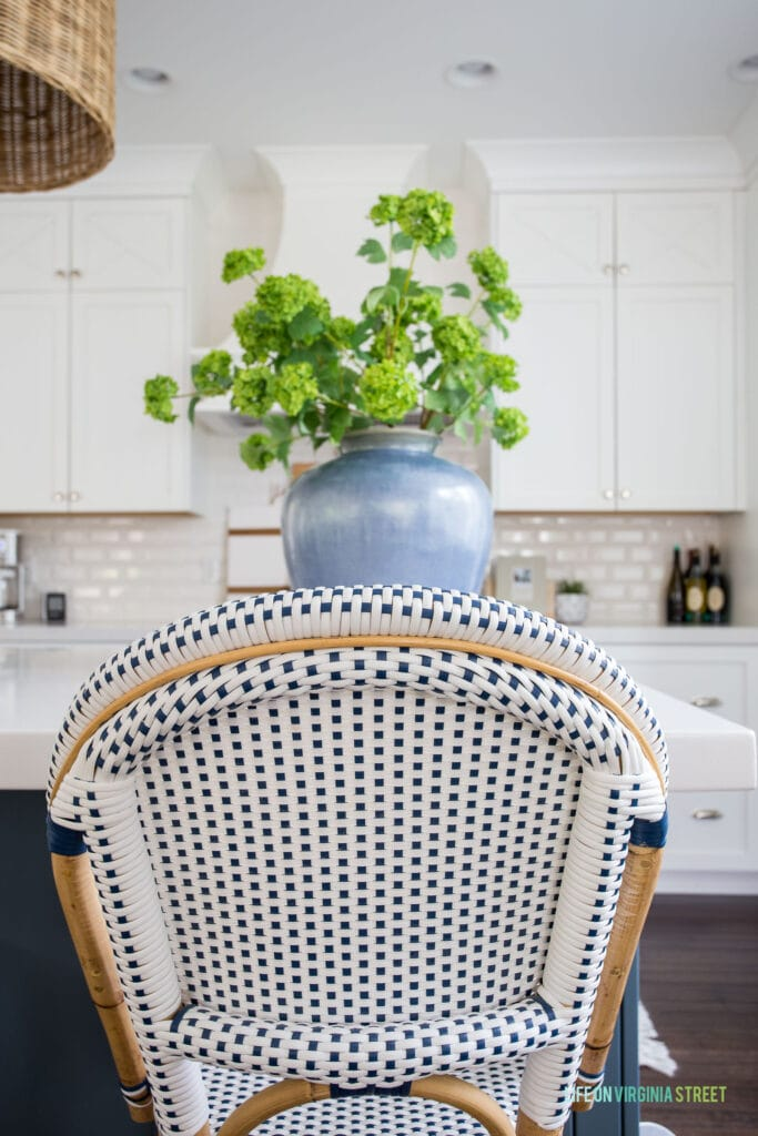 The back view of a Serena & Lily Riviera Counter Stool. This post includes a thorough review after three years of use.