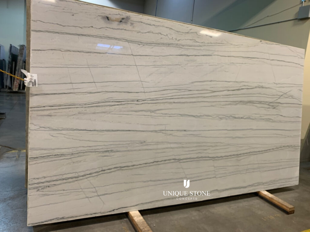 One of the two White Macaubus Quartzite slabs we'll be using on our pool house countertops. We found them at Unique Stone Concepts in Omaha.
