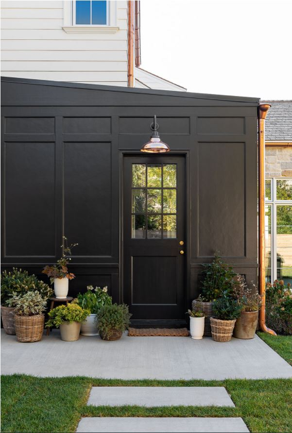 Sherwin Williams Black Magic painted exterior home with board and batten details.