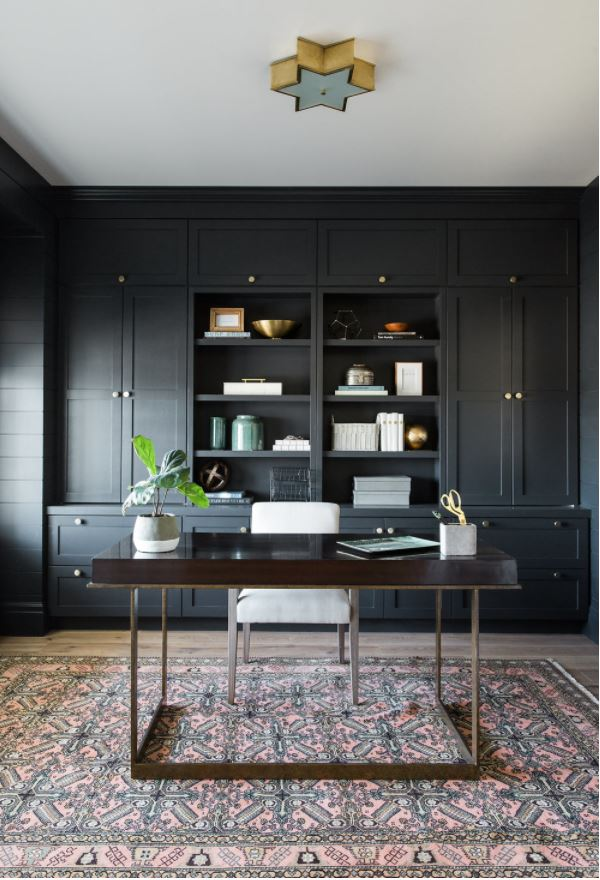 A home office painted in Benjamin Moore Soot, a blue-gray black paint color.
