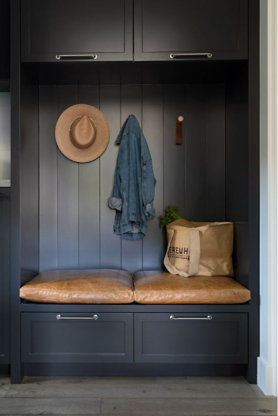 Benjamin Moore Wrought Iron mud room cabinets with leather bench cushions.
