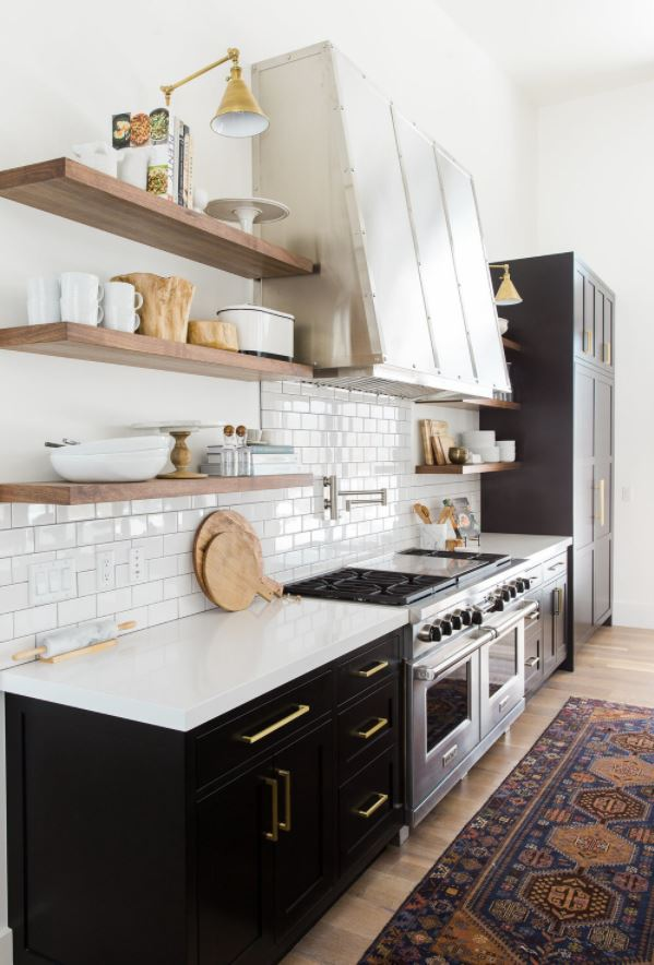 Sherwin Williams Tricorn Black painted lower cabinets in a white kitchen.