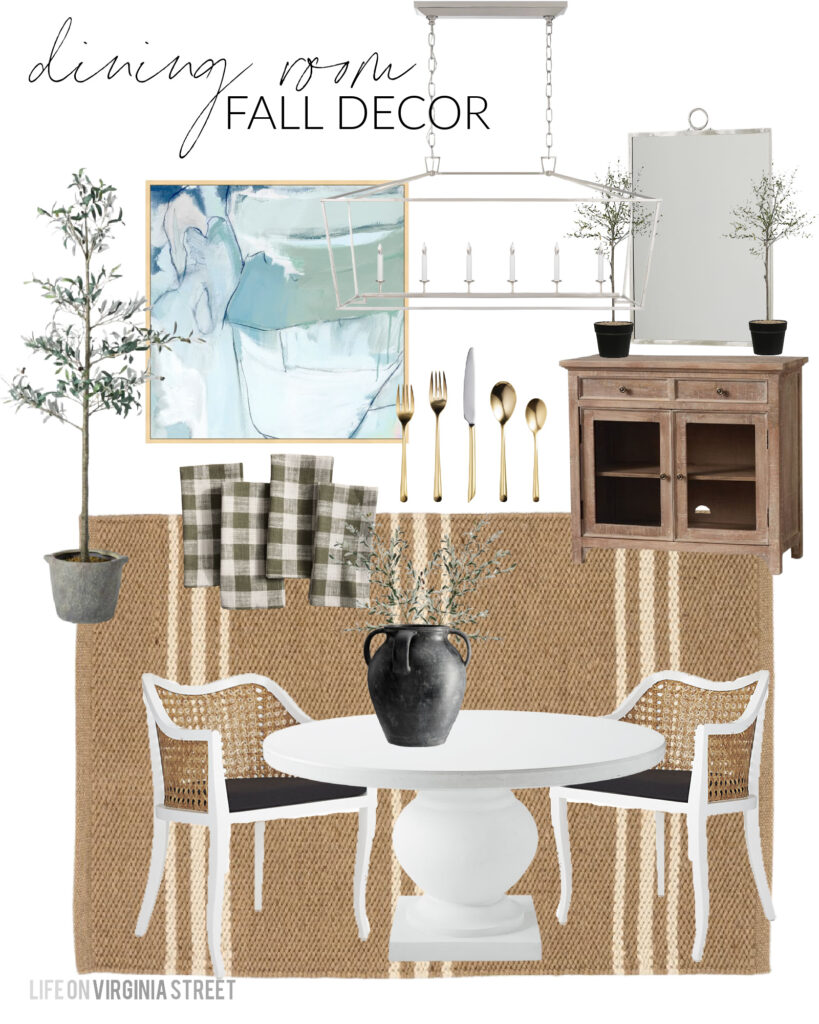 Fall decorating ideas for our dining room including buffalo check linen napkins, a black weathered vase, faux olive stems, faux thyme topiaries, a faux olive tree, a round white dining table, and cane dining chairs!